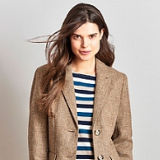 Female model in Crew Clothing jacket and top